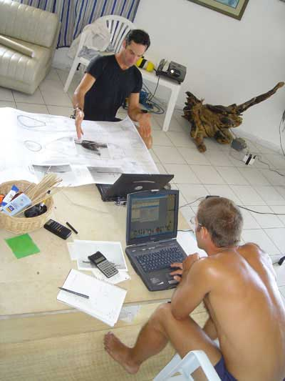 Christian checks blue prints as Paul goes over decompression plans