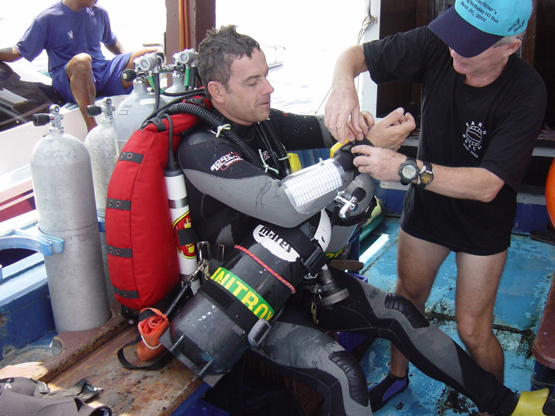 Glen helping me to get ready for 260m dive