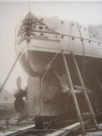 Shipyard scene show ornate and gilt decorationof HMS Victoria's sten